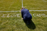 DLM02567   Cindy Oswiany kneels at the 20-yard-line of the Platte Canyon High School football...
