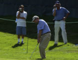(Castle Rock, Colo., August 3, 2004) Davis Love III hits a chip shot while being videotaped by two...