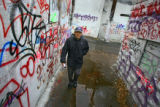 Kelly Calderon (cq) of Denver walks down an alley near Santa Fe and West 8th Avenue past the...
