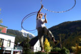 "Andy Cook, cq, Telluride, spins hula hoops while ""slacklining,"" a form of tightrope, in..."