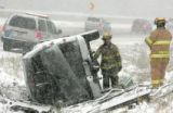 Foothills Fire and Rescue and the  Colorado State patrol investigate a rollover accident in the...