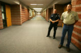 Sgt. Glenn Harding, left, and Sheriff Fred Wegner stand in the hallway of Platte Canyon High...