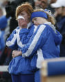 DLM00027   Cheerleader Madeline Figinser, 17, right, hugs Taylor Spangler at the end of the Platte...