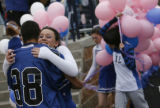 A cheerleader gets a hug from another student before the start of the Platte Canyon High School...