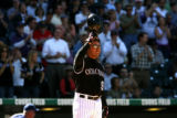 Colorado Rockies Vinny Castilla tips his hat to the crowd at Coors Field, when he came up to bat...