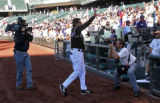 Colorado Rockies Vinny Castilla waves to the crowd after the game Thursday afternoon September 28,...