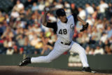 (DENVER, Colorado. August 03, 2004) Rockies vs. Cubs , winning pitcher Kerry Wood pitches in the...