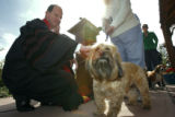 DLM01000   Rev. Dr. John Bell blesses Mr. Tibbs, a six-year-old Terrier mix, during the annual...