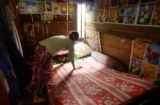 Phnom Penh, Cambodia.  November 7, 2003.   Prostitute Lin Na, 36, straightens out her bed in her...