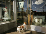Janel Sobeck (cq), operations officer at Muttropolis, a pet boutique, opens the doors a few...