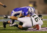 The Air Force Falcons' John Rabold (#9, FAL) forces a fumble out of the Colorado State Rams' Caleb...