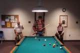 Montrose residents Don Govan, cq, left, Bob Abbott, cq, and Kenny Davis, cq, shoot pool at the...