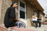 DLM01162   Brandon Thalley, 17, and his mother Loretta Garcia, 46, sit across the street from...