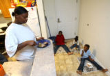 MJM183   Angel Hudson (cq), left, eats dinner with her children,  Dareius Hudson, 8, center to...