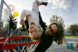 Cheryl Badger (Cq) plays with her son, Liam Badger, 2 1/2, in a new playground that's dedicated to...