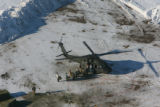 A Colorado Air National Guard UH-60 Blackhawk helicopter is reloaded with hay Wednesday Jan. 3,...