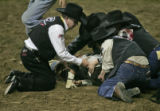 Action stops at the National Western Stock Show Tuesday evening Jan. 16, 2007 as members of the...