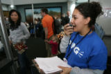 (DLM4267) -  Southwest Airlines marketing manager Tonya Gray, right, uses the gate microphone to...