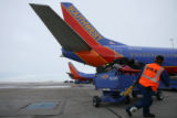 (DLM4295) -  Bags are loaded onto a Southwest Airlines jet headed for Salt Lake City at Denver...