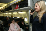 (DLM4280) -  Southwest Airlines flight attendant Stephanie Terrill welcomes passengers aboard a...