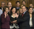 Speaker of the House Nancy Pelosi conducts a mock swearing-in for Rep. Ed Perlmutter, D-Colo., as...