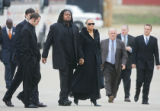 Denver Broncos offensive lineman George Foster (center left) walks in with his wife Chanita...