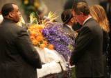[JPM0033] Broncos head coach Mike Shanahan, right, pauses at the casket  at the funeral of Denver...