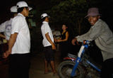 Phnom Penh, Cambodia.  November 6, 2003.   Members of a boat racing team, left, in white, talk to...