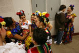 MJM548   Shanae Trujillo, 5, left, is surrounded by fellow dancers as Cody Lewis (cq), 15, right,...