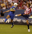 (Denver, Colo., July 21, 2004) Cesar Gonzalez, of Club Atletico Boca Juniors, fights with Rafael...