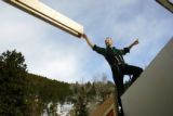 Master german framer Helmut Elbs directs a beam to it's destination on the roof of Mary Ellen...