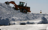 MJM113  A CDOT front loader clears snow drifts across highway 93 as high winds closed the road...