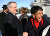 Bill Ritter, shares a funny moment with Sharon Alexander Holt, (cq), Chair of the M.L.K....