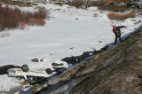 Ken Nelson (cq) of Allied Towing makes his way to Clear Creek after a car crashed down an...