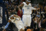 [JPM004] Denver Nuggets Allen Iverson, left, collides with teammate Nuggets forward Carmelo...
