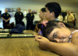 (DENVER, Colo., May 11, 2004) Edilu Torres, 5, waits with her cousin Brian Rivas, 13, to be...