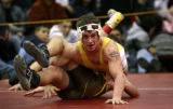 Justin Keys, of Pueblo East (facing) tries a unique way to pin Sean Pellow of Palmer Friday Jan....