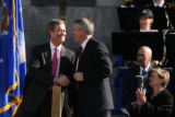 MJM336 Former Colorado Governor, Bill Owens, left shakes hands with current Governor Bill Ritter...