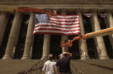 NYT5 - (NYT5) NEW YORK -- August 5, 2004 -- REPUBS-CONVENTION-MEDIA -- Workmen drape a U.S. flag...