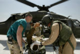 NYT44 - (NYT44) BAGHDAD, Iraq -- Aug. 5, 2004 -- IRAQ-MEDIVAC -- A U.S. Marine that was injured...