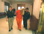 Shawna McKay is led away after being advised of 1st degree murder charges in Weld County District...