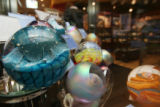 Glass globes for sale in the shop. The Denver Museum of Nature and Science gift store hired new...