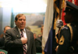 House Minority Leader Mike May, R-Parker, covers his heart as an Honor Guard from the Colorado...
