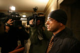 Michael Andre, cq, attorney for Willie Clark, talks with reporters at the Denver City and County...