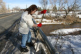 (DLM2659) -  Cindy May, 43, shovels her way through several feet of crusty snow and ice as she...