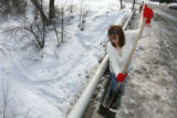 (DLM2785) -  Cindy May, 43, shovels her way through several feet of crusty snow and ice as she...