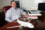 (DLM1385) -  Model planes marking the airlines that Tom Nunn has worked for over his career sit on...