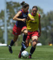 The U.S. women's national team member Julie Foudy, left, against Abby Wambach practices at the...