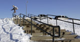 Alex Cutler, 18, takes his turn at a 60 foot stair rail in suburban Boulder County Wednesday...