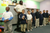 (DLM4080) -   Rev. Leon Kelly watches over some of the boys singing in the second and third grade...